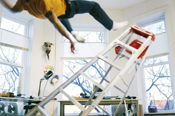 Man falling of ladder showing the risks